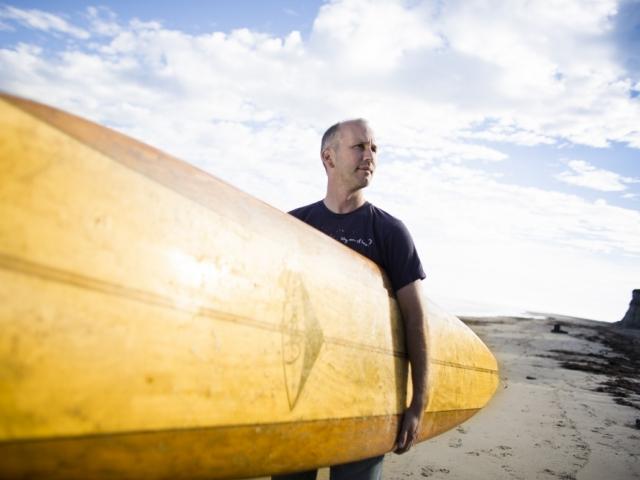 Ben Halpern with surfboard